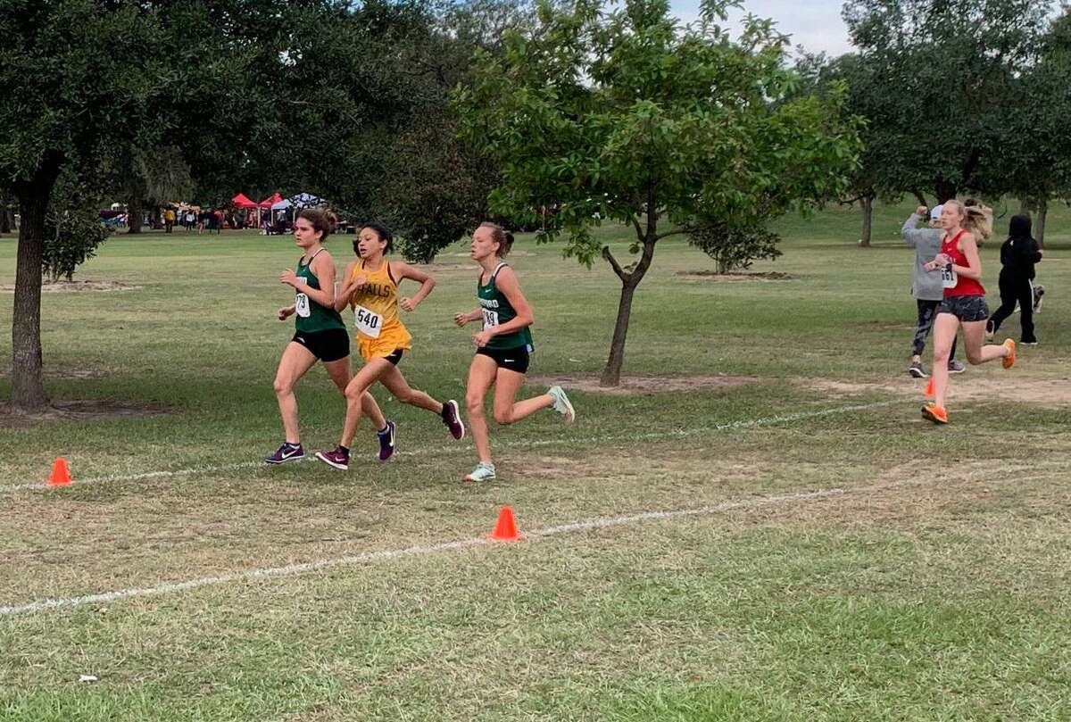 Stratford's Fay Gibb (779), Hope Sage (789), Cypress Falls' Jacqueline Hernandez (540) and Memorial's Chandler Gartner (661) compete in the District 17-6A championships Oct. 17 at Nottingham Park.