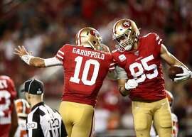 SANTA CLARA, CALIFORNIA - OCTOBER 07:  George Kittle #85 is congratulated by Jimmy Garoppolo #10 of the San Francisco 49ers after Garoppolo threw a touchdown pass to Kittle against the Cleveland Browns at Levi's Stadium on October 07, 2019 in Santa Clara, California. (Photo by Ezra Shaw/Getty Images)