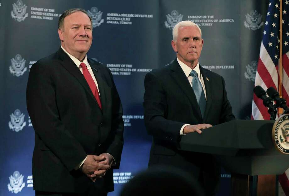 U.S. Vice President Mike Pence, right, speaks at the U.S. ambassador's residence during a news conference with Secretary of State Mike Pompeo, left, after their meeting with Turkish President Recep Tayyip Erdogan, in Ankara, Turkey, Thursday, Oct. 17, 2019. Pence announced that the U.S. and Turkey had agreed to a five-day cease-fire in northern Syria to allow for a Kurdish withdrawal from a security zone roughly 20 miles south of the Turkish border, in what appeared to be a significant embrace of Turkey's position in the week-long conflict. (AP Photo/Burhan Ozbilici) Photo: Burhan Ozbilici / AP