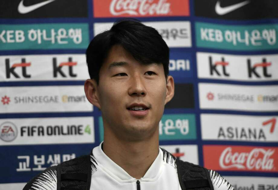 "South Korean footballer Son Heung-min speaks to the media upon his arrival at Incheon airport in Incheon early on October 17, 2019 after the World Cup 2022 Qualifying Asian zone Group H football match between South Korea and North Korea which held at Kim Il Sung Stadium in Pyongyang. - FIFA president Gianni Infantino said he was ""disappointed"" after attending a historic but bizarre World Cup qualifier between North and South Korea that had empty stands and no live broadcast. The rare match in the North Korean capital ended 0-0 on October 15, with Infantino one of the few people allowed to see the surreal game play out at Pyongyang's Kim Il Sung Stadium. (Photo by Jung Yeon-je / AFP) (Photo by JUNG YEON-JE/AFP via Getty Images) Photo: JUNG YEON-JE / AFP or licensors"