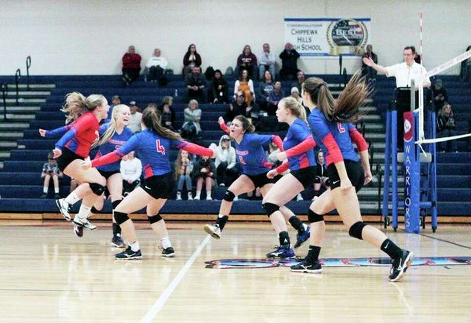 Members of the Chippewa Hills volleyball team celebrate scoring a point after winning a lengthy volley during Thursday's match against Montabella. (Pioneer photo/Joe Judd)