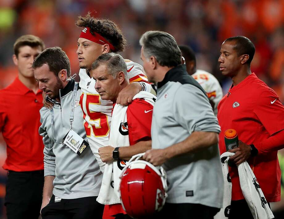 Quarterback Patrick Mahomes (15) of the Kansas City Chiefs is escorted off the field after a knee injury in the first half against the Denver Broncos at Broncos Stadium at Mile High on Thursday, Oct. 17, 2019 in Denver. (Matthew Stockman/Getty Images/TNS) Photo: Matthew Stockman, TNS