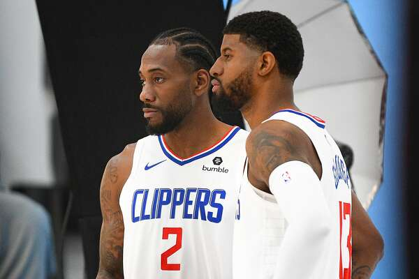 PLAYA VISTA, CA - SEPTEMBER 29: Los Angeles Clippers Forward Kawhi Leonard (2) and Los Angeles Clippers Forward Paul George (13) pose for a picture during media day at the Los Angeles Clippers Training Center on September 29, 2019 in Playa Vista, California. (Photo by Brian Rothmuller/Icon Sportswire via Getty Images)