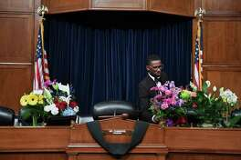 Flowers are put on the desk used by Rep. Elijah Cummings, D-Md., in the chambers for the House Committee on Oversight and Reform where he served as chairman. Cummings died Thursday, Oct. 17, 2019.