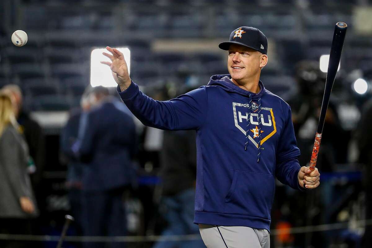 Houston Astros manager AJ Hinch catches the ball during batting practice before Game 4 of the American League Championship Series at Yankee Stadium on Thursday, Oct. 17, 2019, in New York.