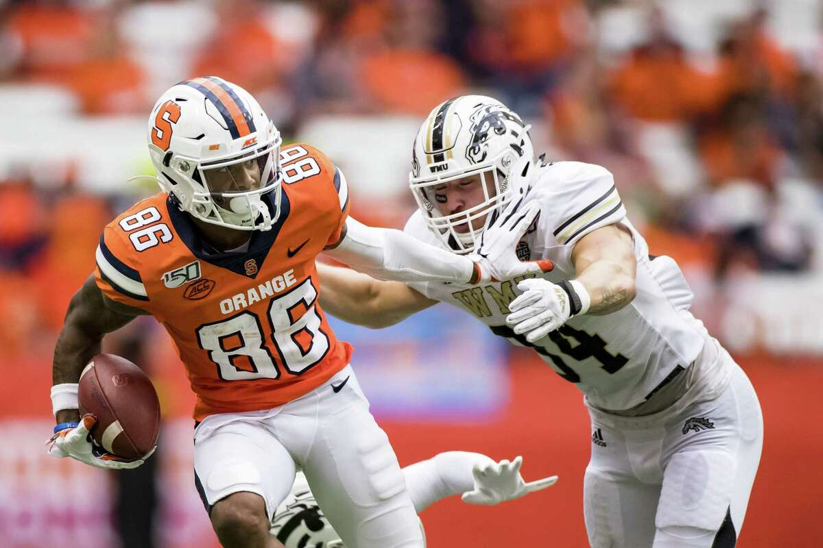 SYRACUSE, NY - SEPTEMBER 21: Trishton Jackson #86 of the Syracuse Orange sheds Anton Curtis #3 and Alex Grace #34 of the Western Michigan Broncos on his way to a touchdown during the third quarter at the Carrier Dome on September 21, 2019 in Syracuse, New York. Syracuse defeats Western Michigan 52-33. (Photo by Brett Carlsen/Getty Images)