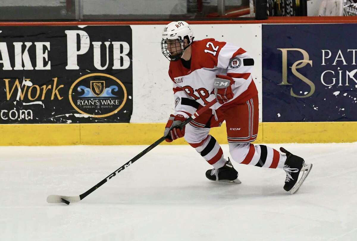 Rensselaer Polytechnic Institute forward Chase Zieky (12) moves the puck to score against Harvard during the first period of an NCAA hockey game Friday, March 1, 2019, in Troy, N.Y., (Hans Pennink / Special to the Times Union)
