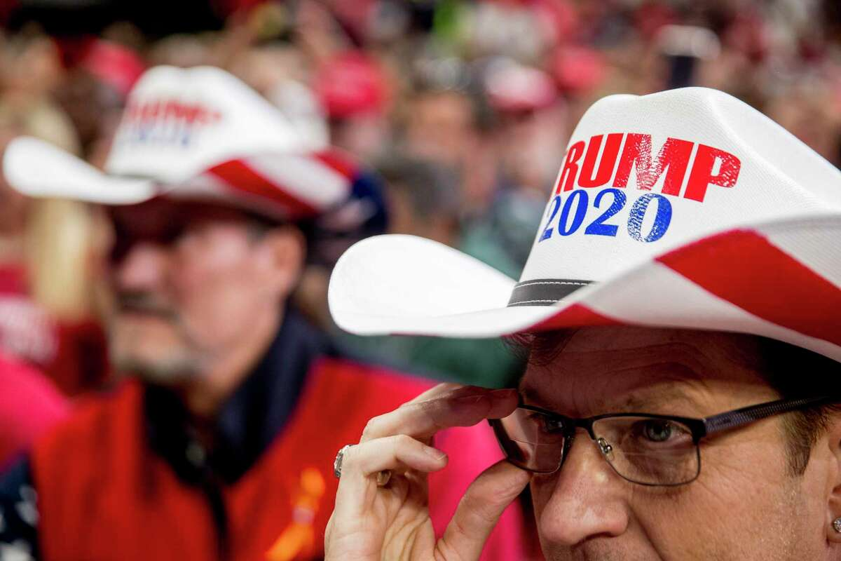 """Members of the audience wear """"Trump 2020"""" cowboy hats as President Donald Trump speaks at a campaign rally at American Airlines Arena in Dallas, Texas, Thursday, Oct. 17, 2019. (AP Photo/Andrew Harnik)"""