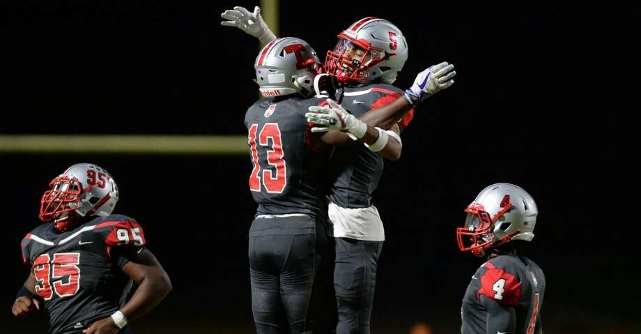 Aundre Smith (13) and Cameron Oliver (5) of Travis celebrate Oliver's interception during the second quarter of a 6A Region III District 20 football game between the Ridge Point Panthers and Travis Tigers on Thursday, October 17, 2019 at Mercer Stadium, Sugar Land, TX. Photo: Craig Moseley/Staff Photographer