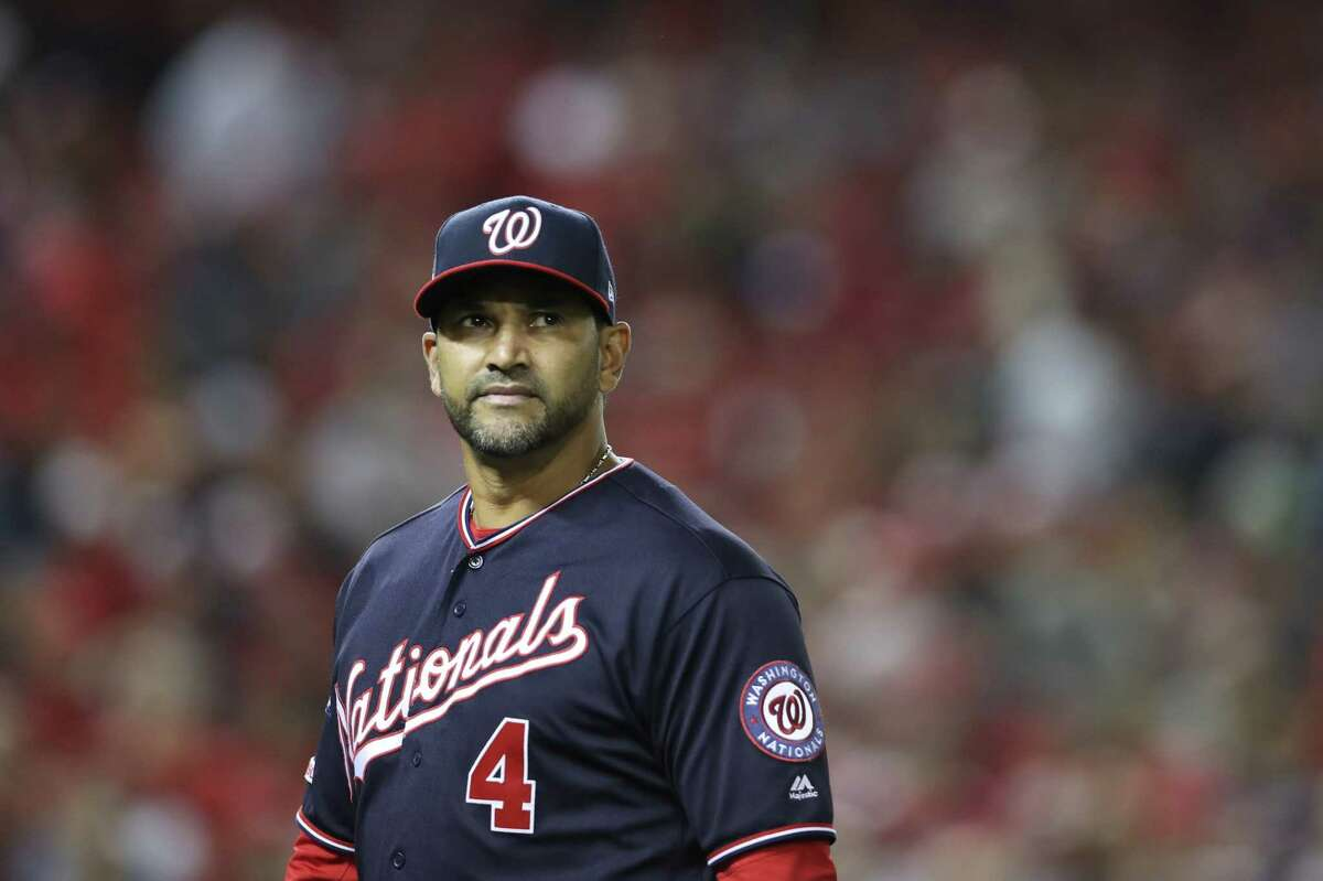 WASHINGTON, DC - OCTOBER 15: Manager Dave Martinez #4 of the Washington Nationals looks on in the eighth inning against the St. Louis Cardinals during game four of the National League Championship Series at Nationals Park on October 15, 2019 in Washington, DC. (Photo by Rob Carr/Getty Images)