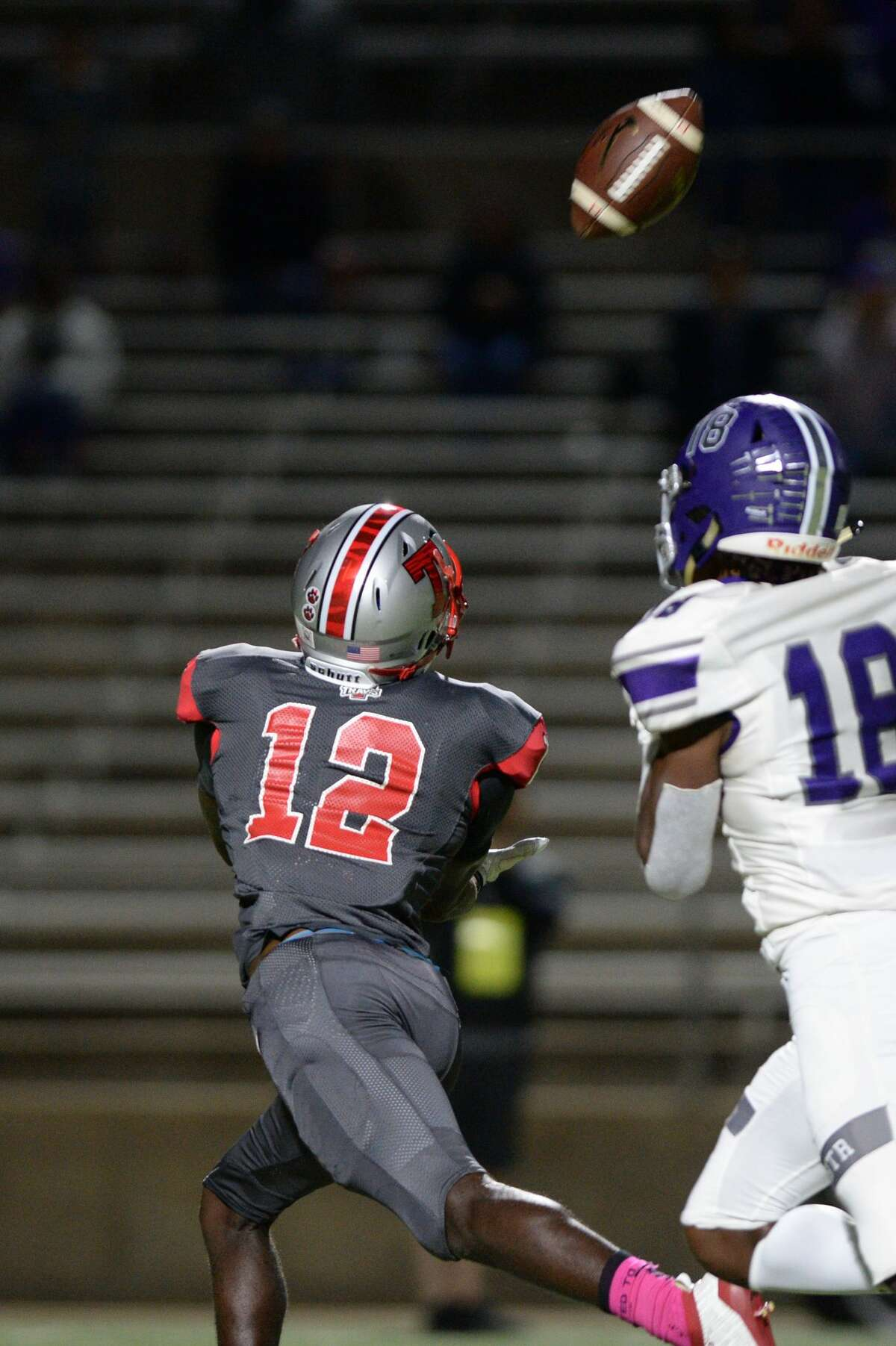 Mike Samba (12) of Travis makes a first down reception during the second quarter of a 6A Region III District 20 football game between the Ridge Point Panthers and Travis Tigers on Thursday, October 17, 2019 at Mercer Stadium, Sugar Land, TX.