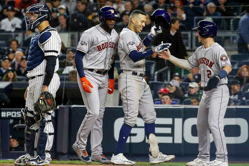 Houston Astros shortstop Carlos Correa (1) celebrates with third baseman Alex Bregman (2) and designated hitter Yordan Alvarez (44) after hitting a three-run home run against New York Yankees relief pitcher Chad Green during the sixth inning of Game 4 of the American League Championship Series at Yankee Stadium on Thursday, Oct. 17, 2019, in New York.