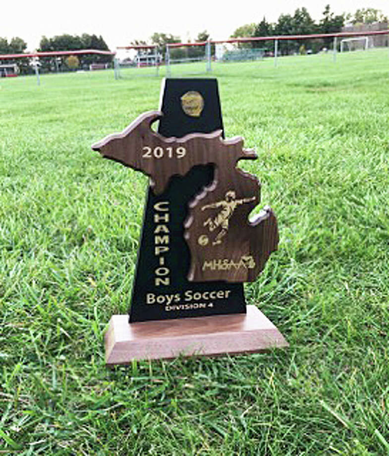 The Bad Axe boys soccer team captured the District 59 boys soccer championship with a win over Saginaw Valley Lutheran in Frankenmuth on Thursday. Photo: Submitted Photo