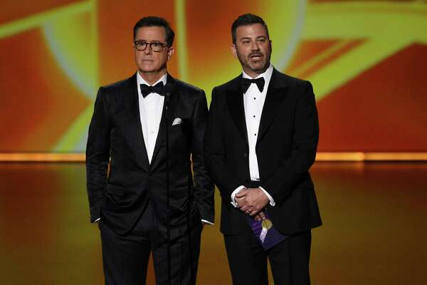 Stephen Colbert, left, and Jimmy Kimmel present the award for outstanding lead actress in a comedy series at the 71st Primetime Emmy Awards on Sunday, Sept. 22, 2019, at the Microsoft Theater in Los Angeles. (Photo by Chris Pizzello/Invision/AP)
