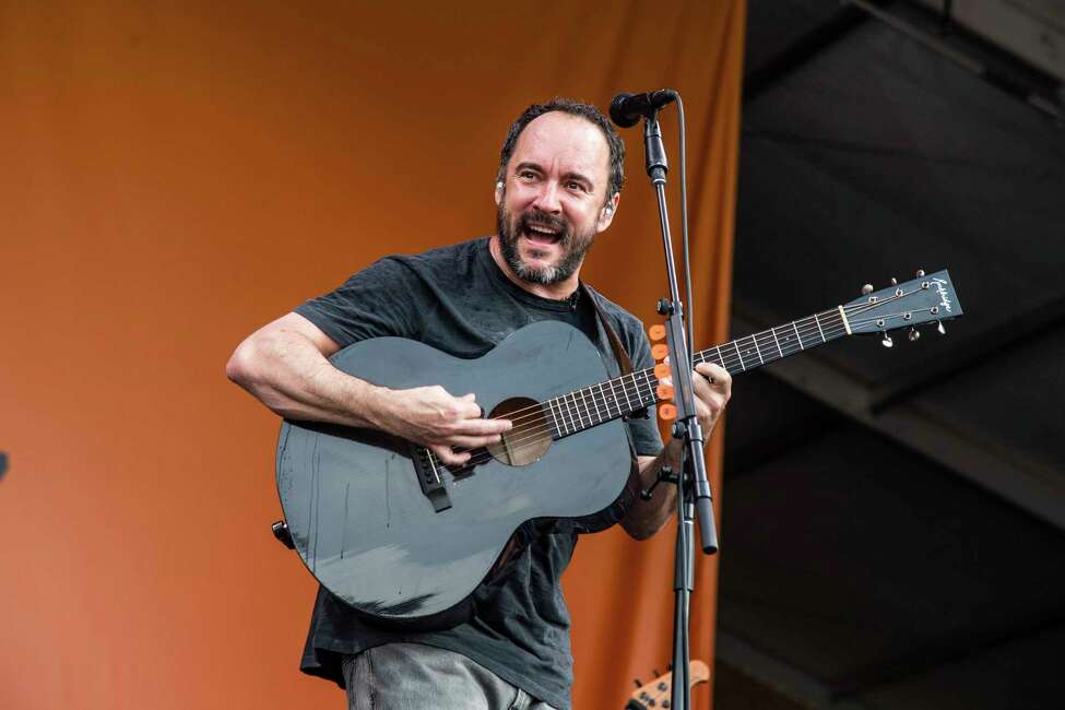 FILE - This May 4, 2019 file photo shows Dave Matthews of the Dave Matthews Band performing at the New Orleans Jazz and Heritage Festival in New Orleans. The Dave Matthews Band are among the 16 acts nominated for the Rock and Roll Hall of Famea€™s 2020 class. (Photo by Amy Harris/Invision/AP, File)