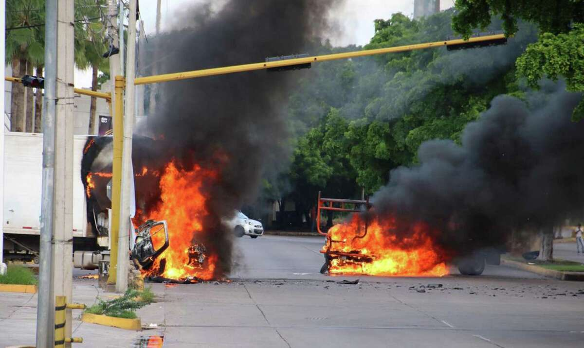 The vehicles burn on a street in Culiacán, Sinaloa state, Mexico, on October 17, 2019.