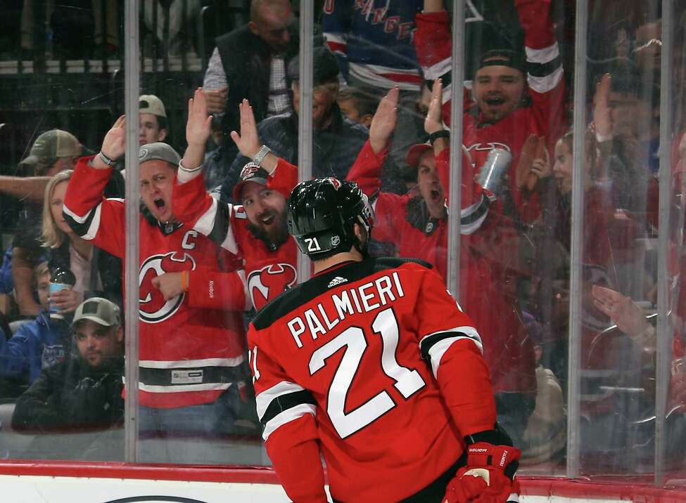 NEWARK, NEW JERSEY - OCTOBER 17: Kyle Palmieri #21 of the New Jersey Devils celebrates his power-play goal at 2:18 of the second period against the New York Rangers at the Prudential Center on October 17, 2019 in Newark, New Jersey. (Photo by Bruce Bennett/Getty Images)