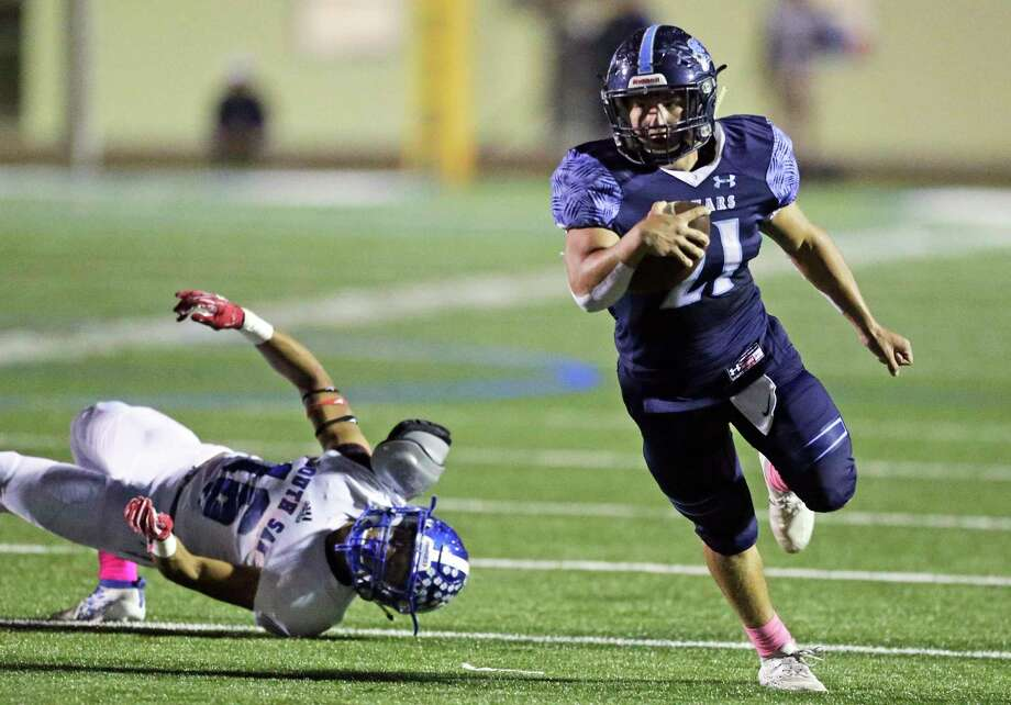 Johnson RB Justin Rodriguez eludes South San's Raymon Dominguez in the Jags' win at Comalander Stadium. Photo: Photos By Tom Reel /Staff Photographer / 2019 SAN ANTONIO EXPRESS-NEWS