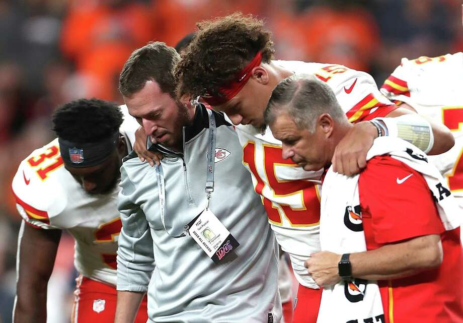 DENVER, COLORADO - OCTOBER 17: Quarterback Patrick Mahomes #15 of the Kansas City Chiefs is escorted off the field after an injury in the first half against the Denver Broncos in the game at Broncos Stadium at Mile High on October 17, 2019 in Denver, Colorado. (Photo by Matthew Stockman/Getty Images) Photo: Matthew Stockman / 2019 Getty Images