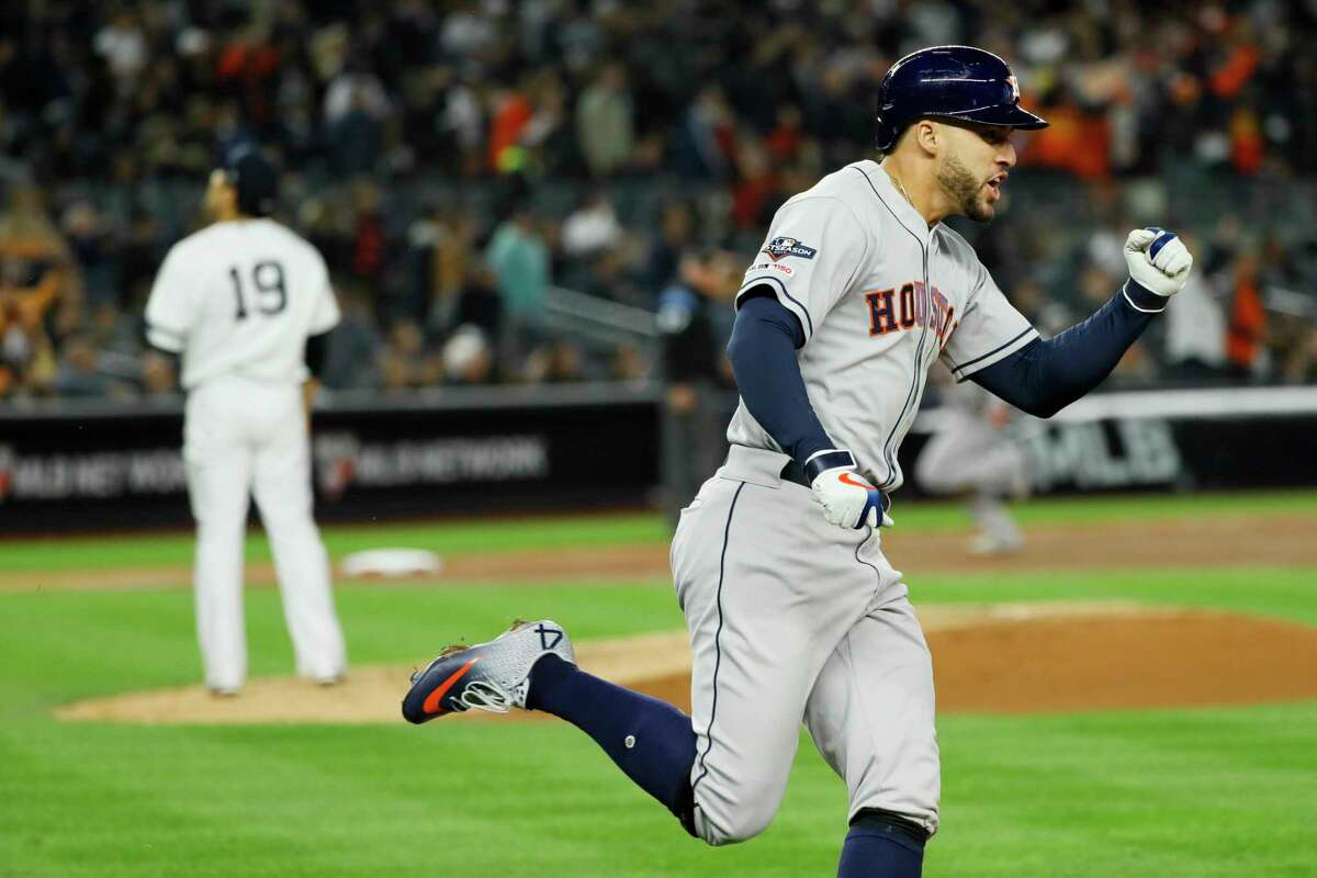 Houston Astros' George Springer, right, celebrates after his three-run home run off New York Yankees starting pitcher Masahiro Tanaka during the third inning in Game 4 of baseball's American League Championship Series Thursday, Oct. 17, 2019, in New York. (AP Photo/Matt Slocum)