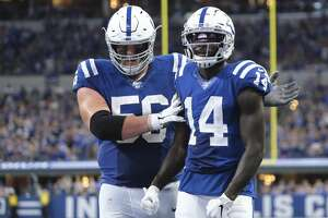 Indianapolis Colts wide receiver Zach Pascal (14) reacts with offensive guard Quenton Nelson (56) during the second half of an NFL football game against the Atlanta Falcons, Sunday, Sept. 22, 2019, in Indianapolis. (AP Photo/AJ Mast)