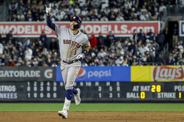 Houston Astros shortstop Carlos Correa (1) celebrates after hitting a three-run home run against New York Yankees relief pitcher Chad Green during the sixth inning of Game 4 of the American League Championship Series at Yankee Stadium on Thursday, Oct. 17, 2019, in New York.