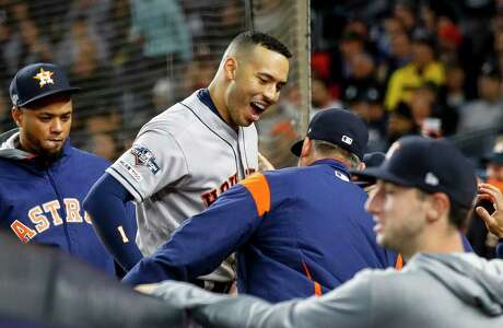 Houston Astros shortstop Carlos Correa (1) celebrates with teammates after hitting a three-run home run against New York Yankees relief pitcher Chad Green during the sixth inning of Game 4 of the American League Championship Series at Yankee Stadium on Thursday, Oct. 17, 2019, in New York.
