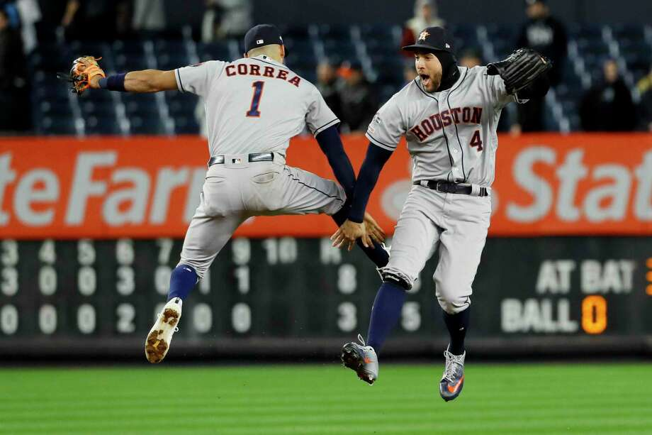 Houston Astros shortstop Carlos Correa, left, and center fielder George Springer celebrate after their 8-3 win against the New York Yankees in Game 4 of baseball's American League Championship Series Friday in New York. Photo: Matt Slocum, STF / Associated Press / Copyright 2019 The Associated Press. All rights reserved