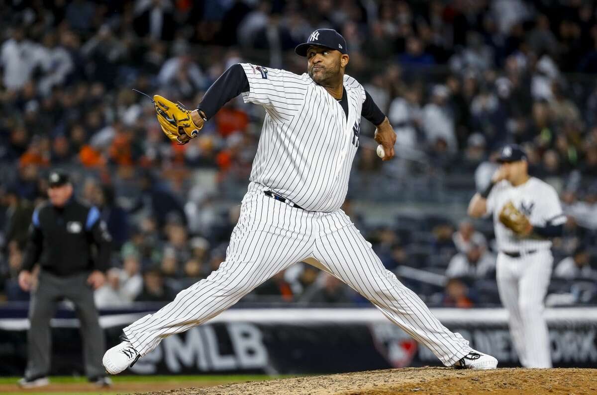 New York Yankees starting pitcher CC Sabathia (52) throws the ball against the Houston Astros during the eighth inning of Game 4 of the American League Championship Series at Yankee Stadium on Thursday, Oct. 17, 2019, in New York.