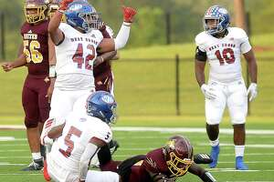 West Brook's Desmond Jackson (far right) reacts as the Bruins sack Beaumont United during the Alumni Bowl Saturday. The game was rescheduled after cancellation Friday due to lightning.   Photo taken Saturday, October 05, 2019 Kim Brent/The Enterprise
