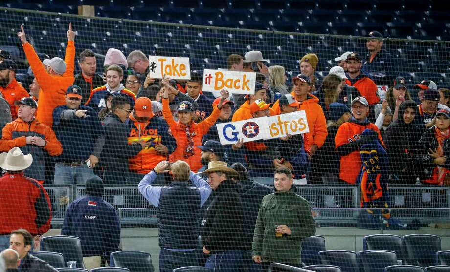 Houston Astros fans celebrate after the Astros defeated the New York Yankees 8-3 in Game 4 of the American League Championship Series at Yankee Stadium on Thursday, Oct. 17, 2019, in New York. Photo: Brett Coomer, Staff Photographer / © 2019 Houston Chronicle