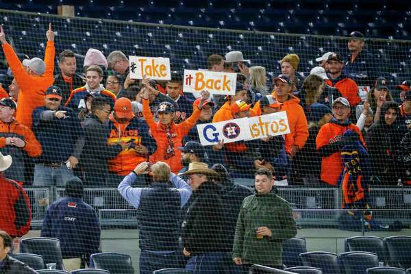 Houston Astros fans celebrate after the Astros defeated the New York Yankees 8-3 in Game 4 of the American League Championship Series at Yankee Stadium on Thursday, Oct. 17, 2019, in New York.