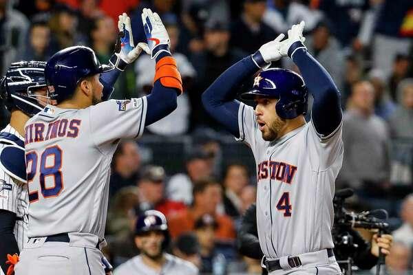 Astros center fielder George Springer (4) quieted the Yankee Stadium crowd with a three-run homer that scored Robinson Chirinos (28) and Josh Reddick in the third.