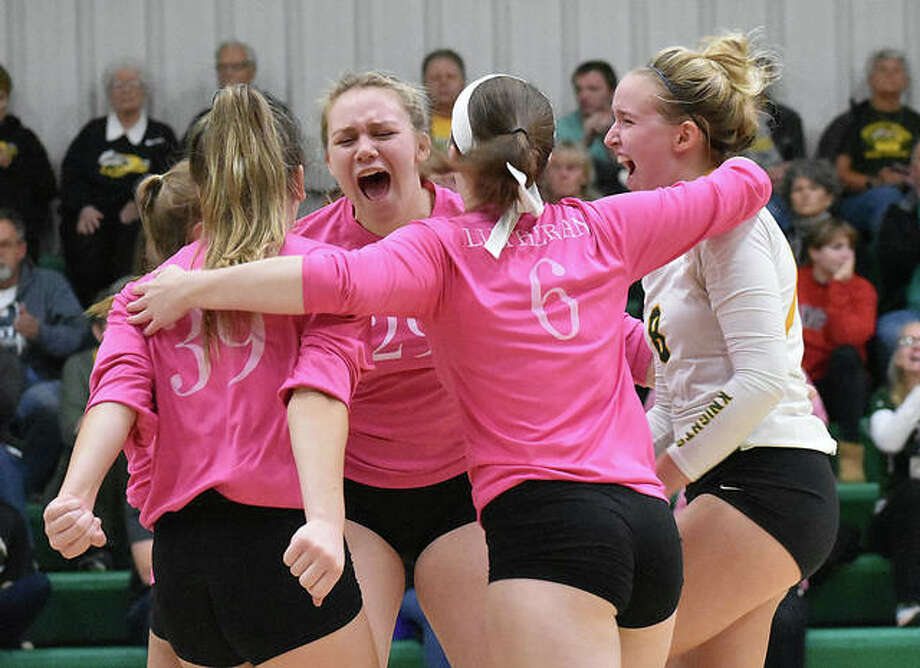 Metro-East Lutheran celebrates after claiming the final point of a three-game win over Father McGivney. Photo: Matt Kamp|The Intelligencer