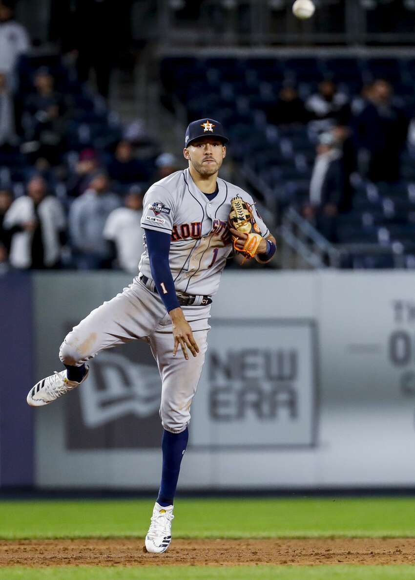 Houston Astros shortstop Carlos Correa (1) throws to first base for the putout during the ninth inning of Game 4 of the American League Championship Series at Yankee Stadium on Thursday, Oct. 17, 2019, in New York.