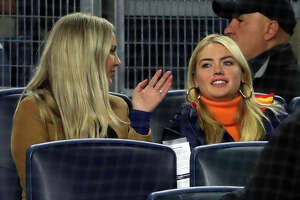 BRONX, NY - OCTOBER 17:  Amy Crawford takes with Kate Upton in the stands during Game 4 of the ALCS between the Houston Astros and the New York Yankees at Yankee Stadium on Thursday, October 17, 2019 in the Bronx borough of New York City. (Photo by Alex Trautwig/MLB Photos via Getty Images)