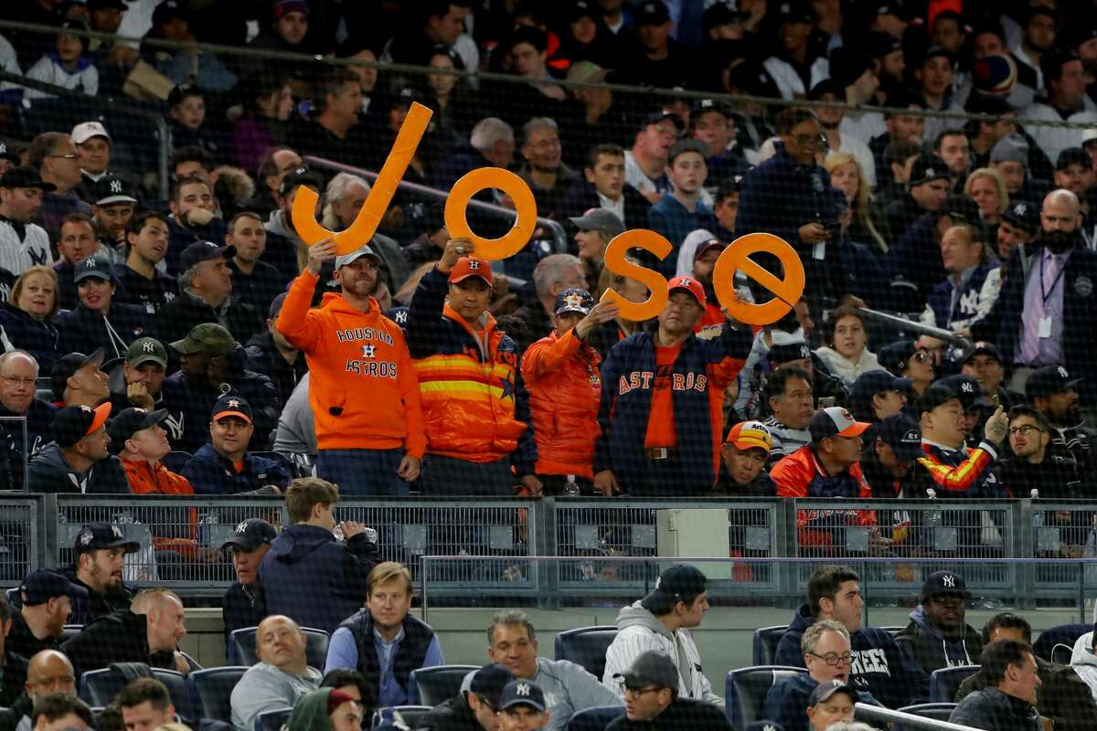 BRONX, NY - OCTOBER 17: Houston Astros fans hold up a Jose sign for Jose Altuve #27 of the Houston Astros during Game 4 of the ALCS between the Houston Astros and the New York Yankees at Yankee Stadium on Thursday, October 17, 2019 in the Bronx borough of New York City. (Photo by Alex Trautwig/MLB Photos via Getty Images)