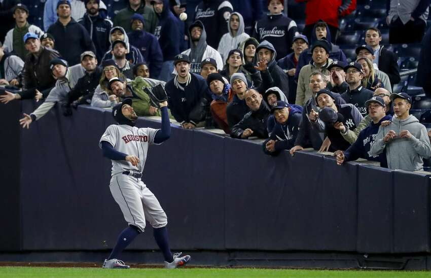 Houston Astros right fielder George Springer (4) catches a ball hit by New York Yankees second baseman Gleyber Torres to end Game 4 of the American League Championship Series at Yankee Stadium on Thursday, Oct. 17, 2019, in New York. The Astros won 8-3, taking a 3-1 lead in the series.