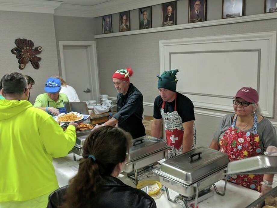 More than 500 people attended the fourth annual Christmas Kindness dinner at the Knights of Columbus Hall in Gladwin. Some of the proceeds from the event went to support Christmas Kindness, who help with winter clothing, blankets and presents during the holiday season. Volunteers ushered in the Christmas spirit by wearing holiday outfits. (Tereasa Nims/for the Daily News)