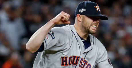 Houston Astros relief pitcher Ryan Pressly (55) reacts after striking out New York Yankees designated hitter Edwin Encarnacion to end the fifth inning of Game 4 of the American League Championship Series at Yankee Stadium on Thursday, Oct. 17, 2019, in New York.