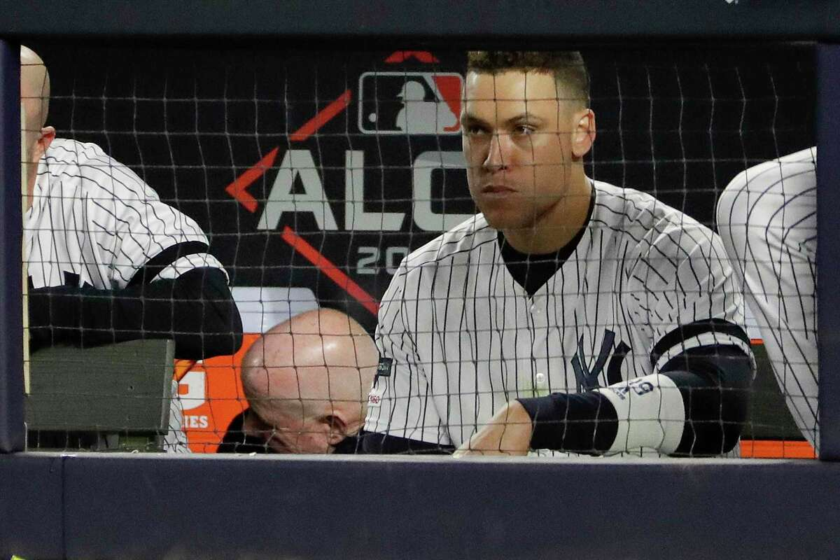 New York Yankees right fielder Aaron Judge watches from the dugout during the eighth inning of Game 4 of baseball's American League Championship Series against the Houston Astros, Thursday, Oct. 17, 2019, in New York.