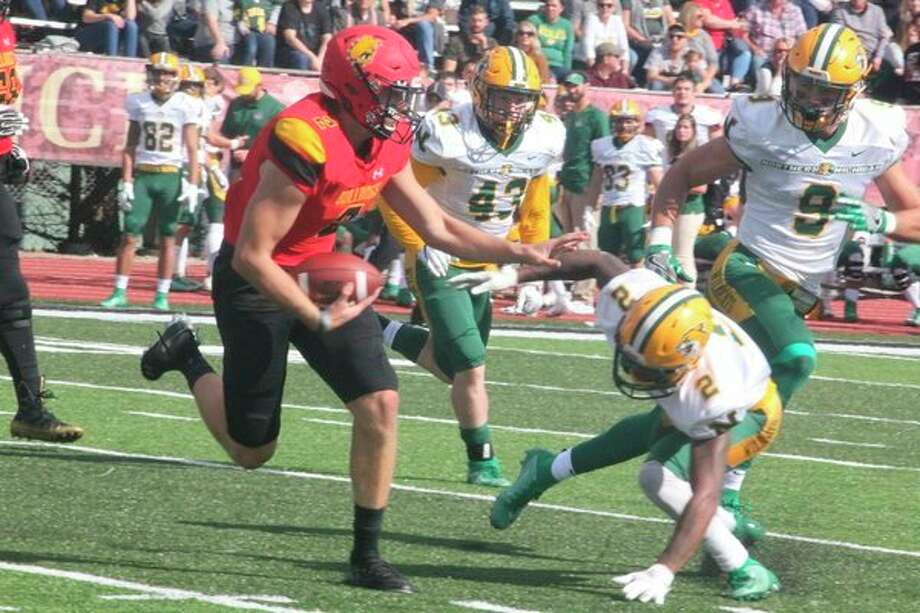 Ferris' Evan Cummins runs for yardage against Northern Michigan earlier this season. (Pioneer file photo)