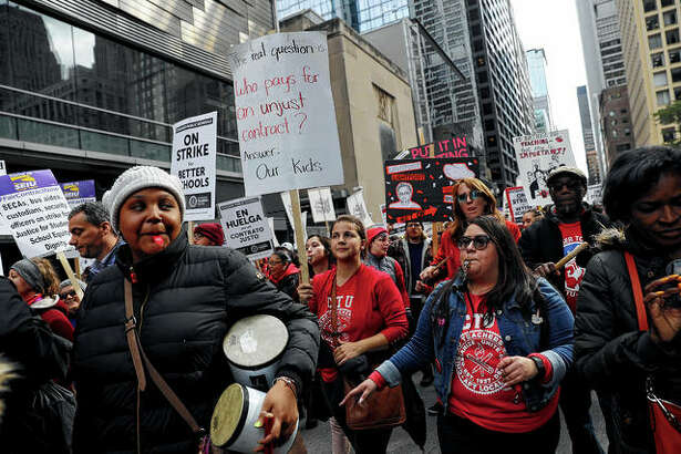 Striking Chicago Public Schools teachers and supporters rally Thursday in front of CPS headquarters in downtown Chicago.