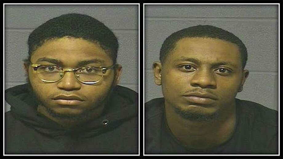 Robert Swan, 19, of Bloomfield, left, and Jermaine Cox, 25, of Hartford, were arrested on robbery and conspiracy charges on Wednersday, Oct. 19, 2019. Hartford police said man, who was selling a cell phone on social media, was robbed when he on the University of Hartford campus. Photo: Hartford Police Photo