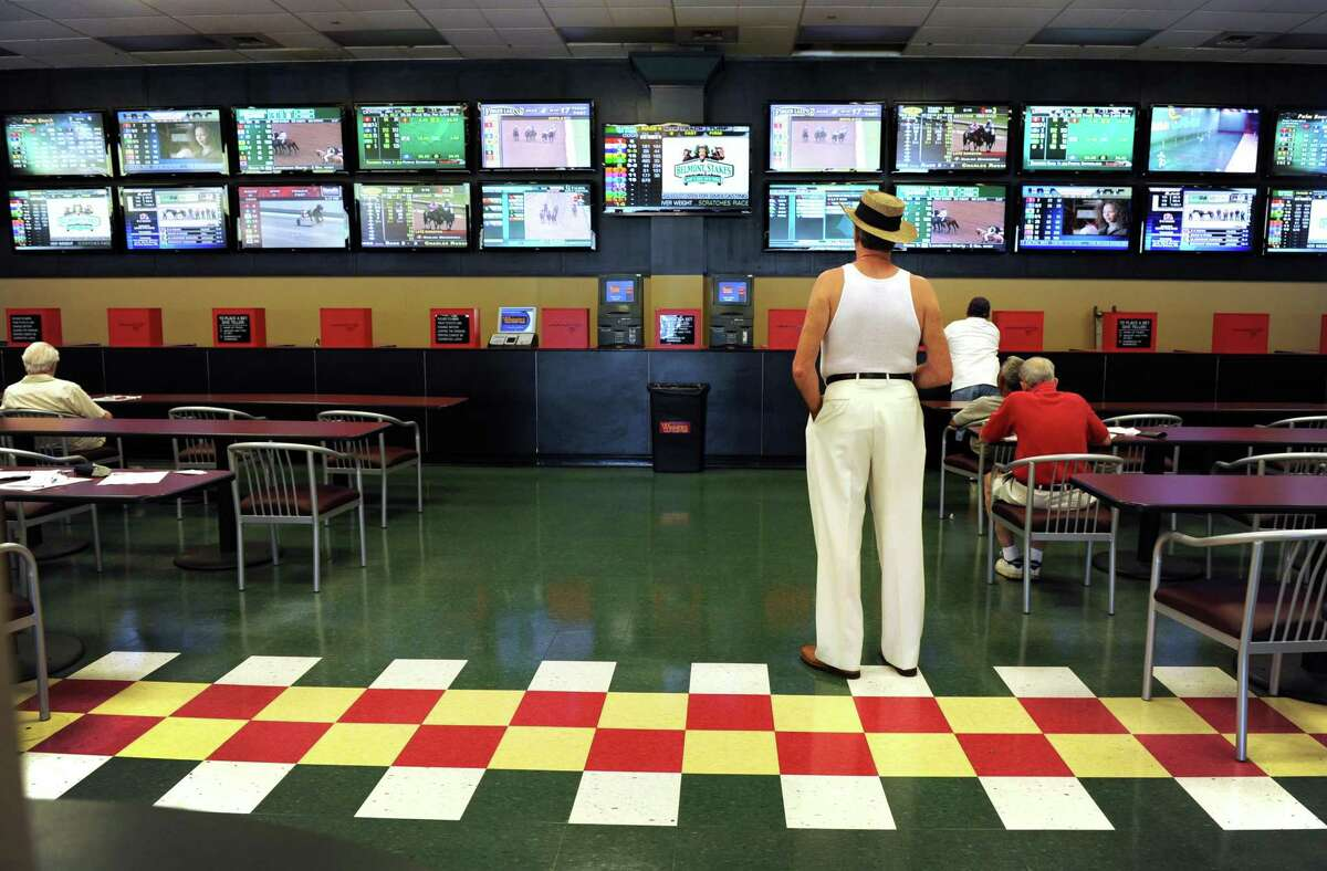 Betters watch the races at Bridgeport's Shoreline Star greyhound racetrack in Bridgeport in 2012. The now-shuttered facility is aluded to in a new book set in Connecticut.