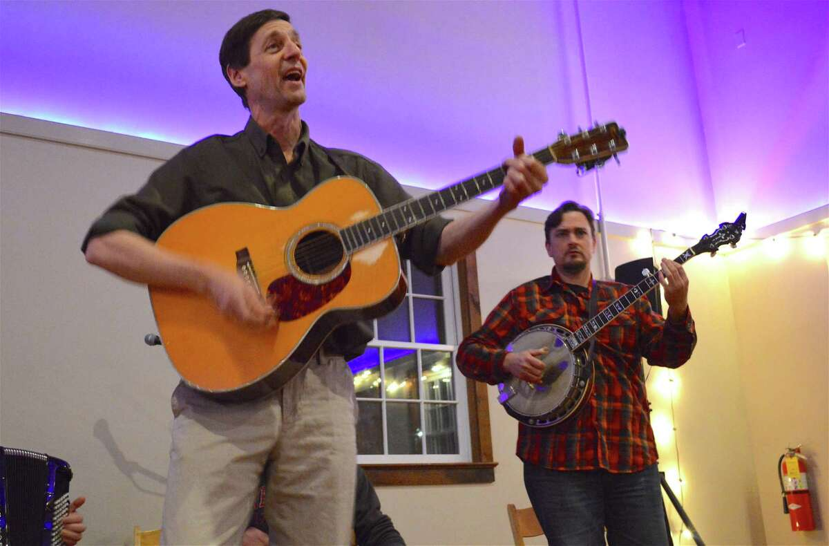 Actor David Lutken, left, who will be starring in the upcoming production as folk legend Woody Guthrie, and Eric Anthony of Queens, N.Y., perform at the Westport Country Playhouse's