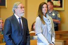 Michelle Troconis, with her attorney Andrew Bowman, appears for a hearing at Stamford Superior Court, Friday, Oct. 4, 2019 in Stamford, Conn.