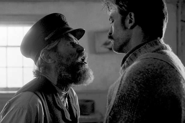 "Willem Dafoe and Robert Pattinson star as sparring lighthouse keepers who drive each other mad in Robert Eggers's ""The Lighthouse."""