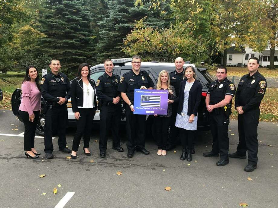 In honor of Domestic Violence Awareness Month, victim advocates from the The Women's Center of Greater Danbury came by the Lounsbury House to visit and thank members of the Ridgefield Police Department on Wednesday, Oct. 16. Photo: Ridgefield Police Department / Facebook
