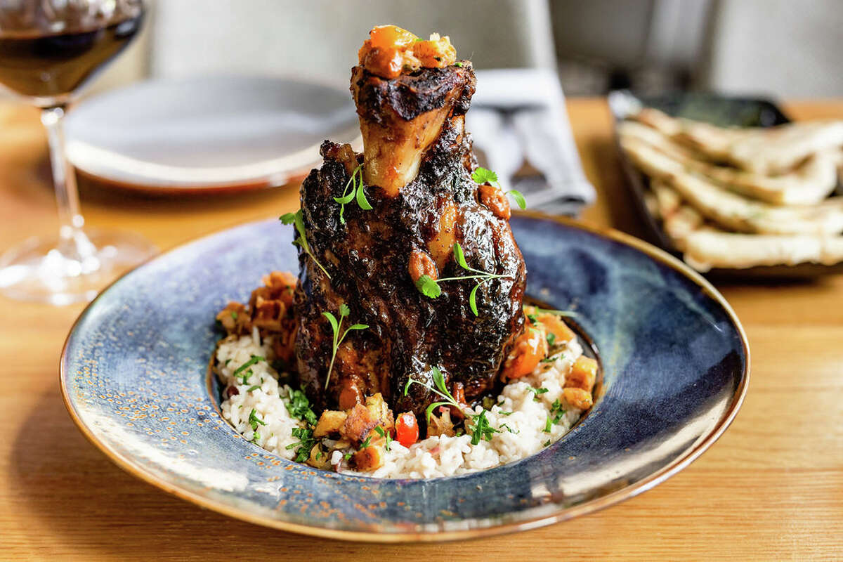 Jamaican jerk smoked pork shank with collard greens, rice and beans and plantain and smoked tomato relish at Traveler's Table.